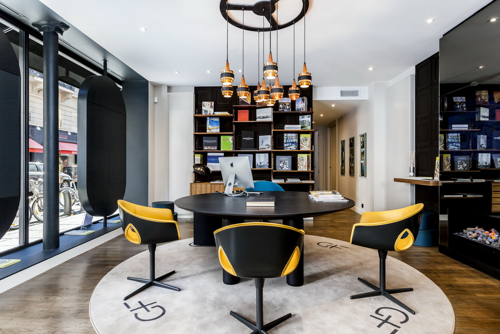 yellow work chairs,luxury office design,high end apartments paris,showroom design ideas,yellow and black workplace solutions,