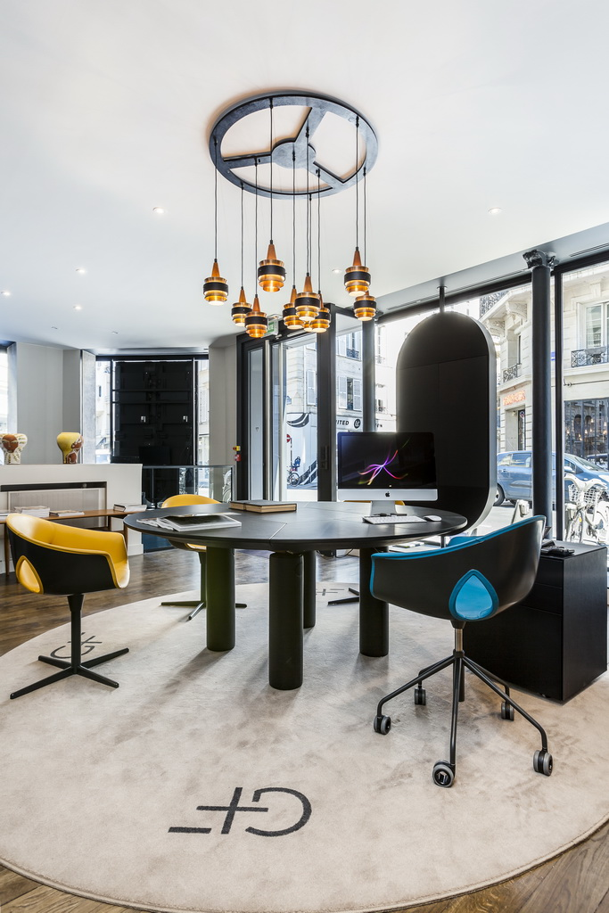 artistic meeting rooms,gray and yellow office chairs,high end office design,luxury apartments paris,showroom design interior,