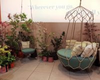 hanging chair garden furniture,hanging lounge chair outdoor,green and white outdoor cushions,luxury outdoor furniture brands,salone del mobile milan outdoor furniture fair,