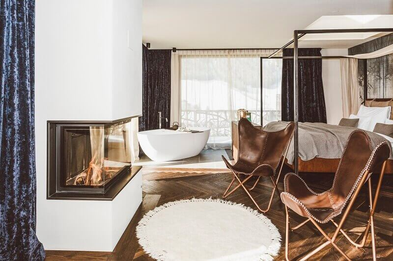 hotel room with a canopy bed ideas,hotel room with a fireplace,romantic weekend getaways fireplace,silena hotel valles,best design hotels italy,