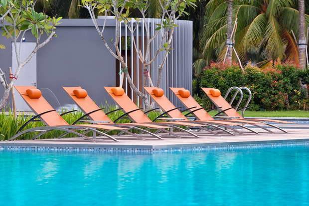 orange sun lounger luxury,w singapore sentosa cove pool,royal botania sun loungers,modern hotel pool design,singapore best hotel in sentosa,