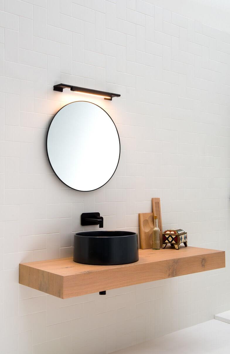 led lights above bathroom mirror,black round washbasin,creative led lighting ideas,led light bar bathroom,black wash basin on a wood stand,