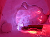 igloo themed bedroom,beds made of ice,red led lights in bedroom,apple wall art ice,winter inspired hotel room decor,