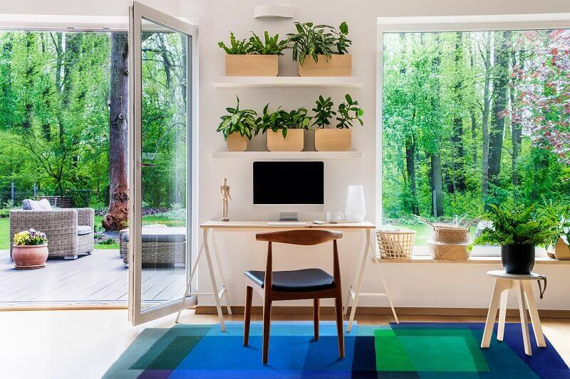 home office with garden view,indoor plants home office,greenery home office interior design,colors decor for home office flooring,home office in blue and green colour combination,