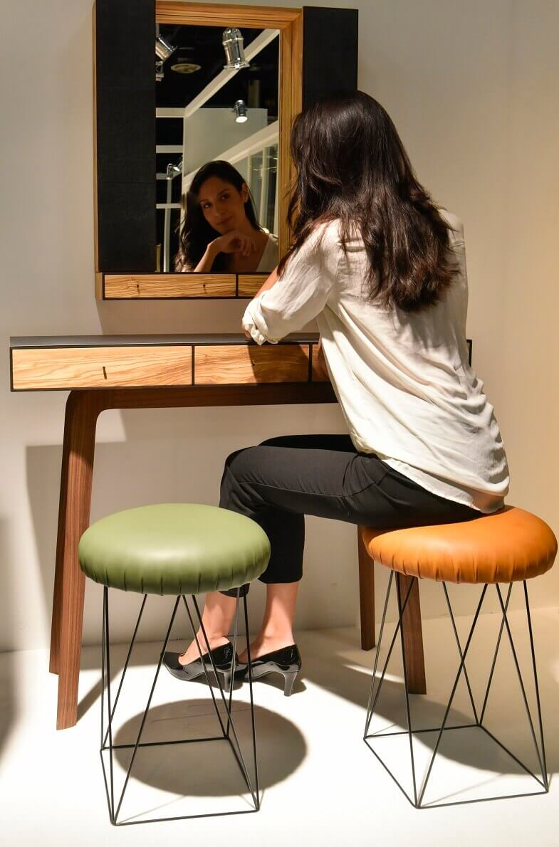 furniture for small spaces,wooden console table with mirror,console table modern apartment,woman looking in mirror,wooden ideas for interior design,