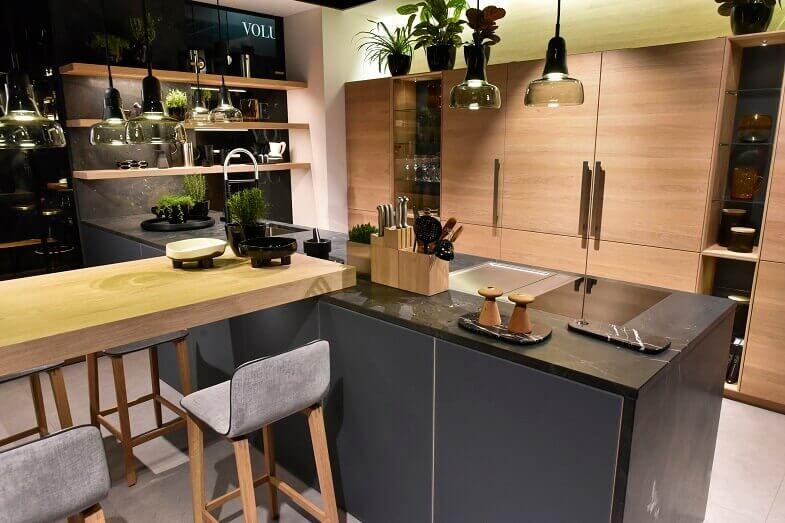 modern wood kitchen cabinets,dark grey and wood kitchen,wooden kitchen bar table,light gray upholstered bar stools,kitchen design trends 2020,
