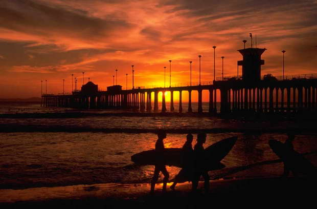 surfers on the beach,colorful sunset images,pier on the beach,seaview homes,romantic date night ideas,