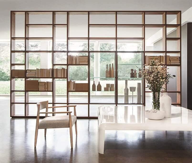 designer bookshelves images,contemporary home library,ideas for living room storage,designer bookshelves modern shelving,how to divide living room space,