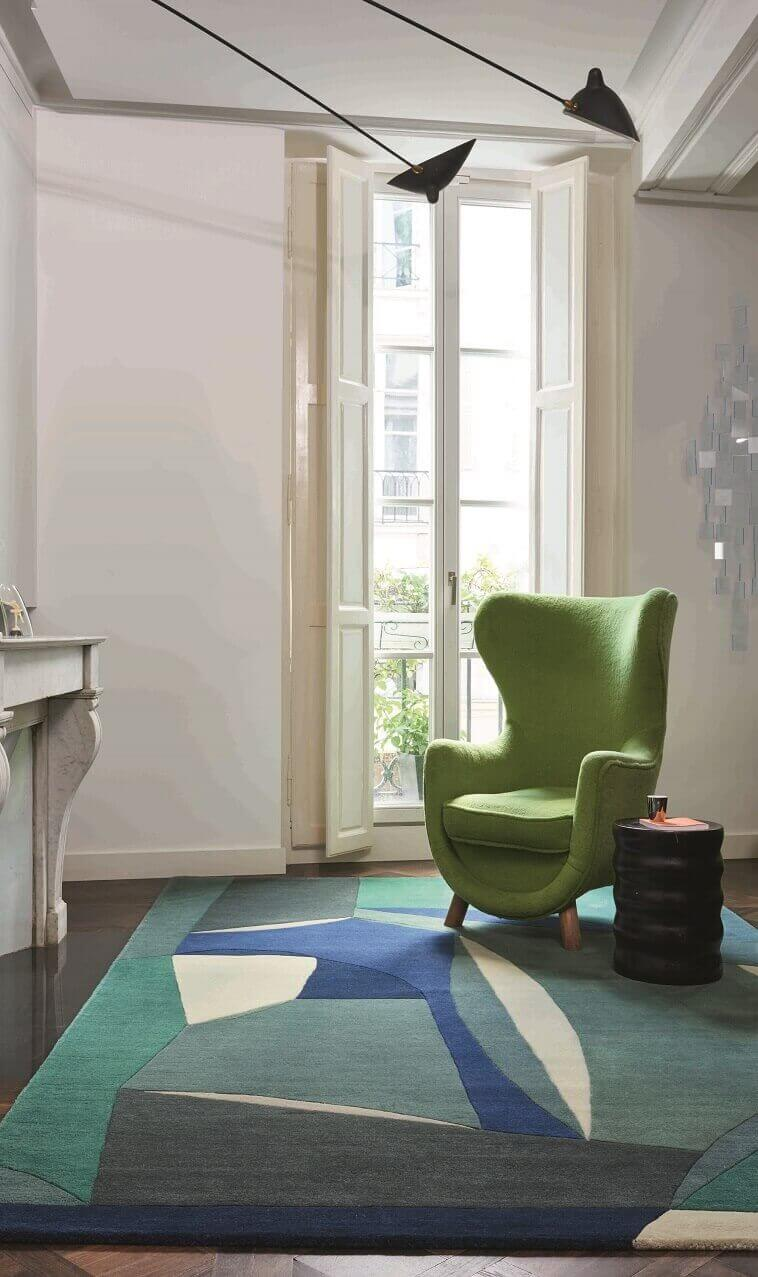 matching sofa and carpet,light green sofa decorating ideas,blue green white area rug,how to design a reading corner,pastel colors decorating ideas,