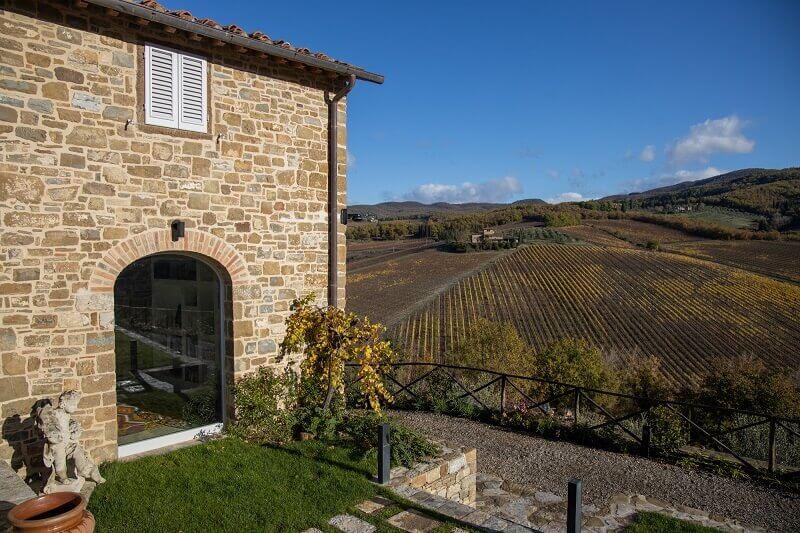 italian stone house design,stone house vineyard italy,tenuta di carleone chianti,winery in tuscany italy,tuscan architecture style,