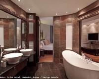 mirror design for bathroom,large mirror with ornate frame,tribe hotel kenya nairobi,design hotels in africa,hotel bathroom in brown color schemes,