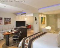 tribe hotel nairobi kenya,hotel room design africa,open plan bedroom living room home office,work desk in bedroom,hotel suite design ideas,