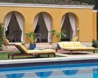 luxury poolside furniture,yellow garden decor,villa garden design ideas,sunbeds by swimming pool,high end italian outdoor furniture,