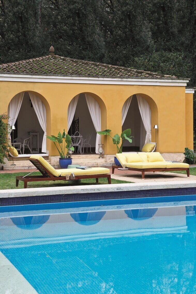 sunbeds by swimming pool,high end italian outdoor furniture,luxury poolside furniture,yellow garden decor,villa garden design ideas,
