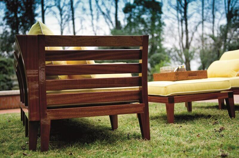 outdoor wooden sofa with cushions,yellow seat cushions outdoor,yellow outdoor decor,luxury outdoor seating area,italian outdoor sofas,