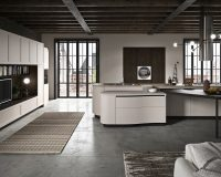 large kitchen island with stone worktop,high end kitchen cabinets,tv and home library in the kitchen,luxury white kitchen design ideas,open space kitchen layout,