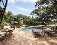 wooden pool deck designs,lounge pool deck design,wild coast tented lodge yala sri lanka,eco friendly hotel design,eco resort planning and design,