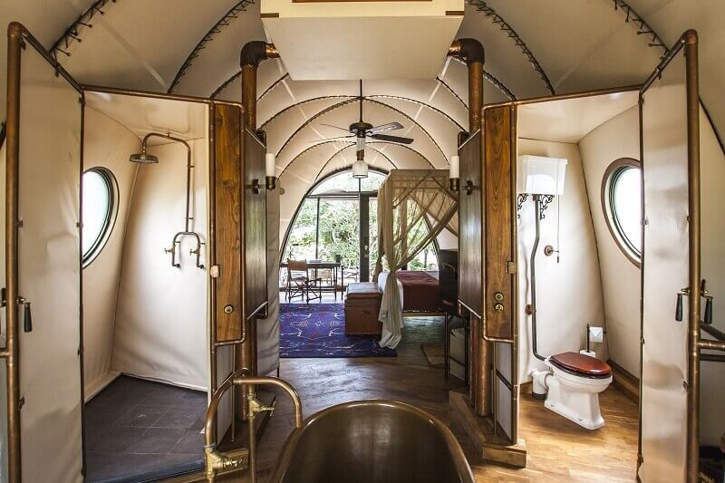 steampunk bathroom glamping,steampunk toilet design glamping,cocoon-like pod resort,luxury pod accommodation,steampunk bathroom decor,