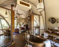 steampunk bathroom glamping,steampunk bedroom design,steampunk interior design ideas,cocoon-like pod resort,luxury pod accommodation,