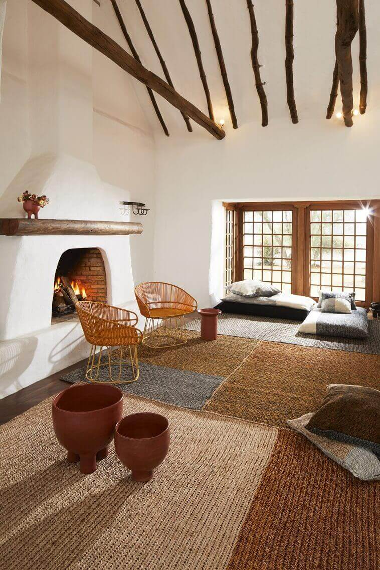 rustic living room ideas with fireplace,south american style living room ideas,designer carpet made of plant fibers,warm house decorating ideas,ethnic living room decorating ideas,