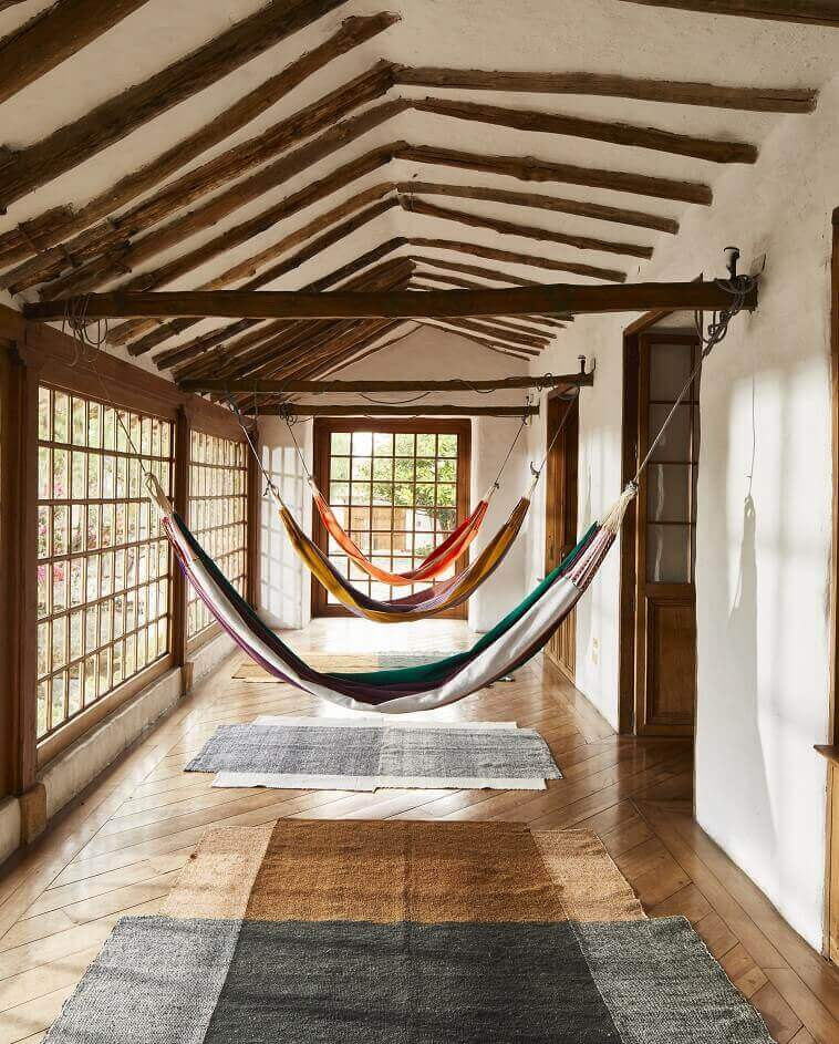 south american hammock decor style,bedroom ideas with hammocks,rustic wooden architectural elements,maraca colors furniture,colombian crafted furniture,