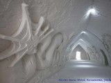 arctic snow hotel lapland finland,corridor made of ice snow,best ice hotels in scandinavia,vacation ideas for winter,hotel hallway design ice snow,