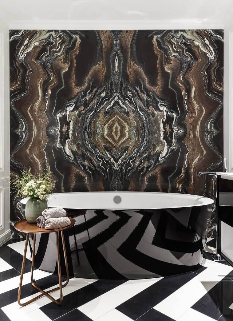 black and white herringbone tile pattern,small round copper side table,marble wall panels for bathrooms,awarded bathroom design ideas modern,black freestanding bathtub luxury bathroom,