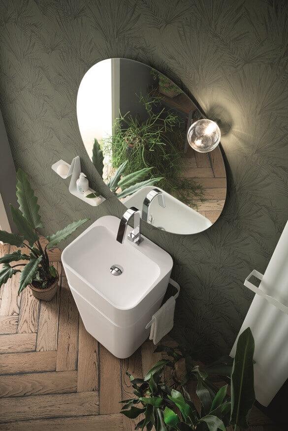 plants in home decor,greenery in bathroom,green bathroom wallpaper,white wash basin design,round mirror bathroom,