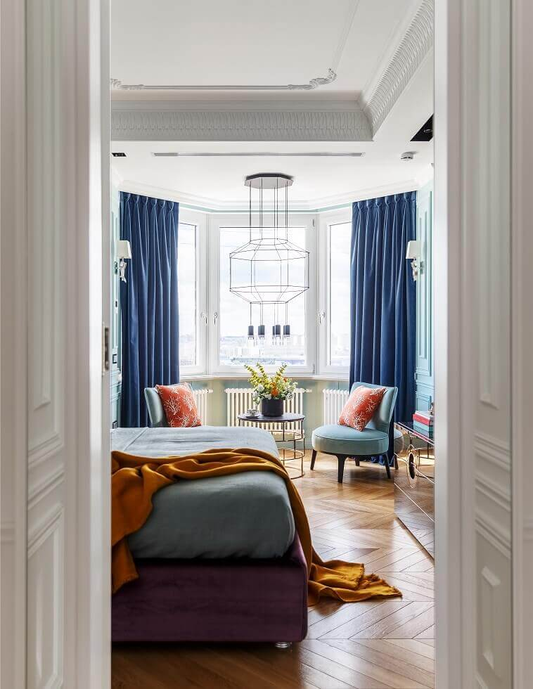 luxury bedroom with bay window ideas,hexagon ceiling light fixture,turquoise color accent chairs,turquoise orange blue decor schemes,master bedroom with sitting area decorating ideas,