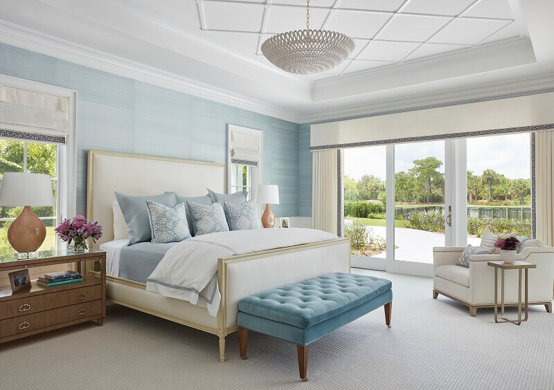 light blue and white bedroom decorating ideas,bedroom with a garden view,coastal style bedroom décor,romantic coastal bedroom ideas,white and blue bedroom ideas,
