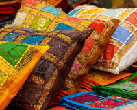 colorful cushions on sofa,ethnic style home decor,interior decorating ideas,colorful fabric texture,home decor,