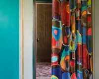 complementary colors blue and orange,complementary color pairs,blue wall design ideas,colorful decorative curtains,interior decorating ideas,