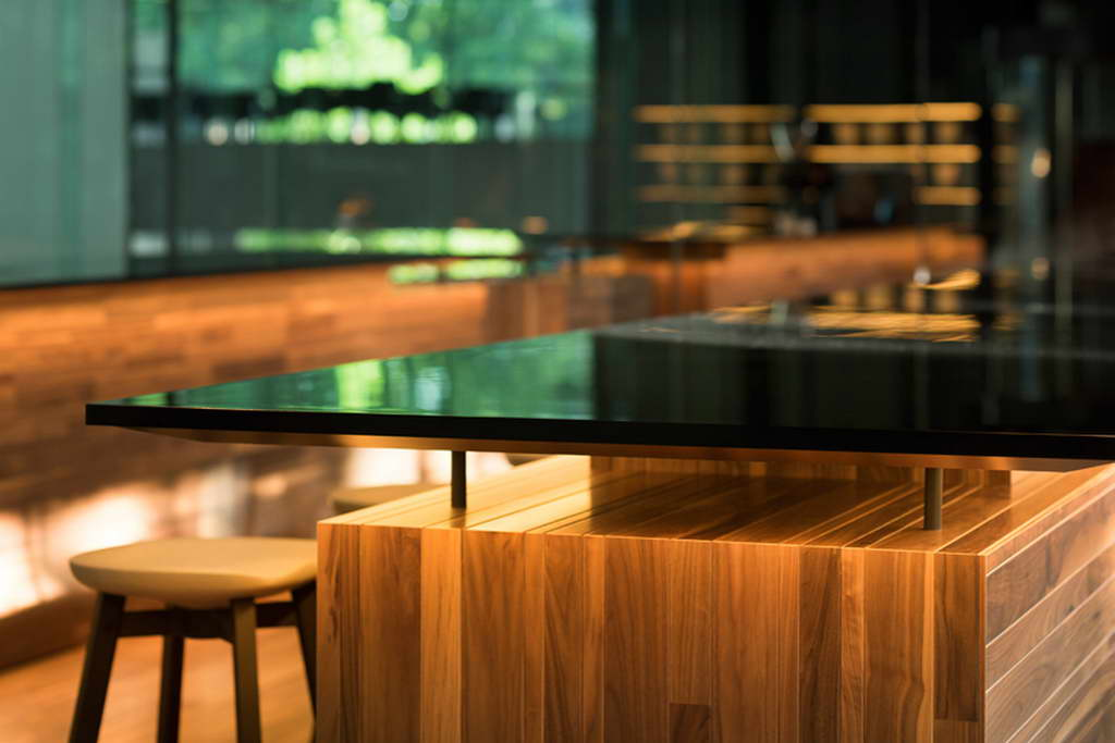 wood and glass bar interior design,connel coffee tokyo,cafe design project by nendo,contemporary bar and restaurant design,wooden cafe design,