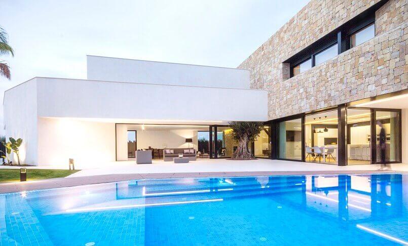 swimming pool design ideas,outdoor design sofa,outdoor design house,designer garden furniture,contemporary stone façade,