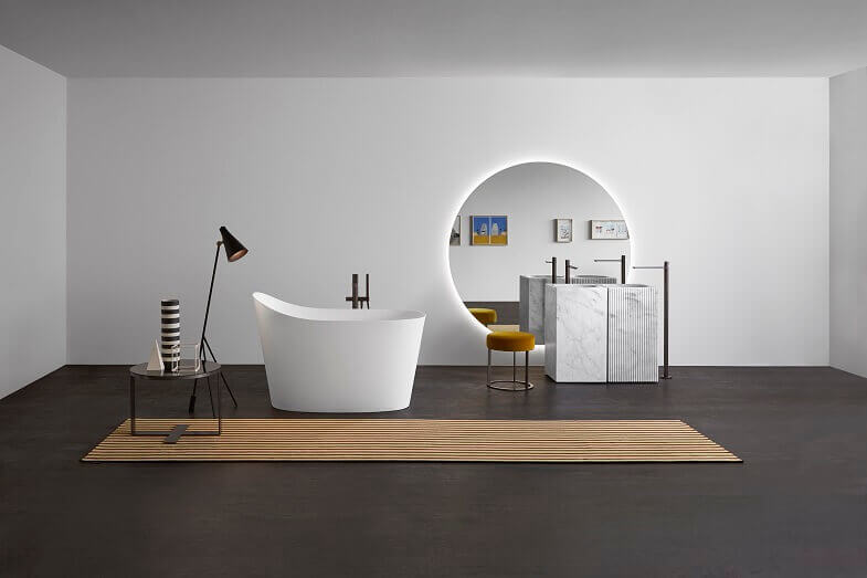 white luxury freestanding bathtubs,large round decorative wall mirrors,freestanding marble stone sink,gray brown and white bathroom ideas,floor lamp by the bathtub,