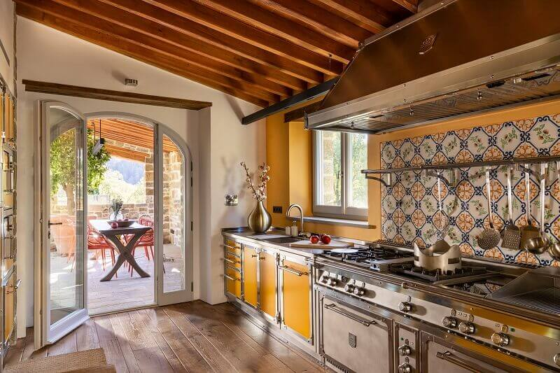 tailor made kitchen cabinets,tuscan kitchen design ideas,yellow kitchen with stone wall ideas,colorful kitchen backsplash ideas,yellow kitchen cabinet ideas,