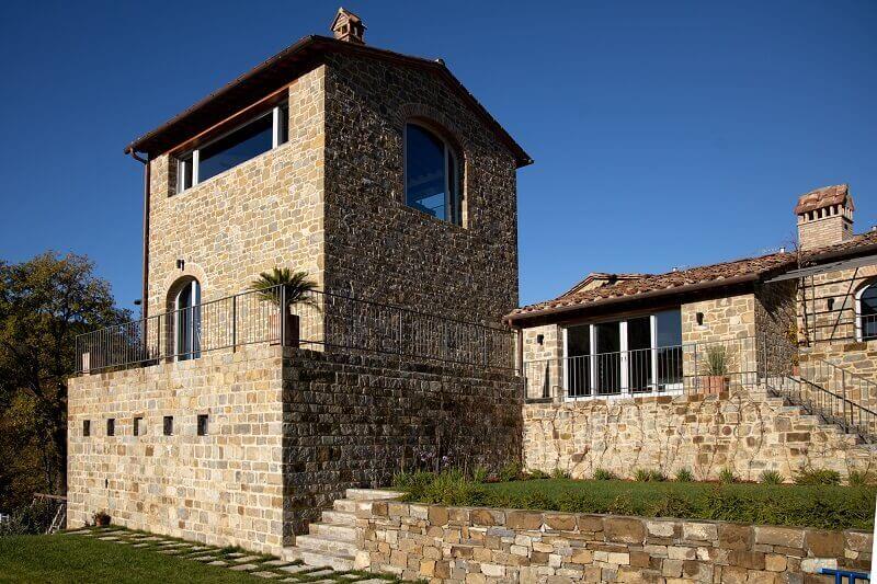 tenuta di carleone chianti,winery in tuscany italy,tuscan architecture style,italian stone house design,stone house vineyard italy,