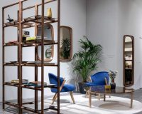 freestanding bookcase room divider,wooden bookshelf design,mirrors with wooden frame,blue velvet armchair wooden,round coffee table with wooden legs,