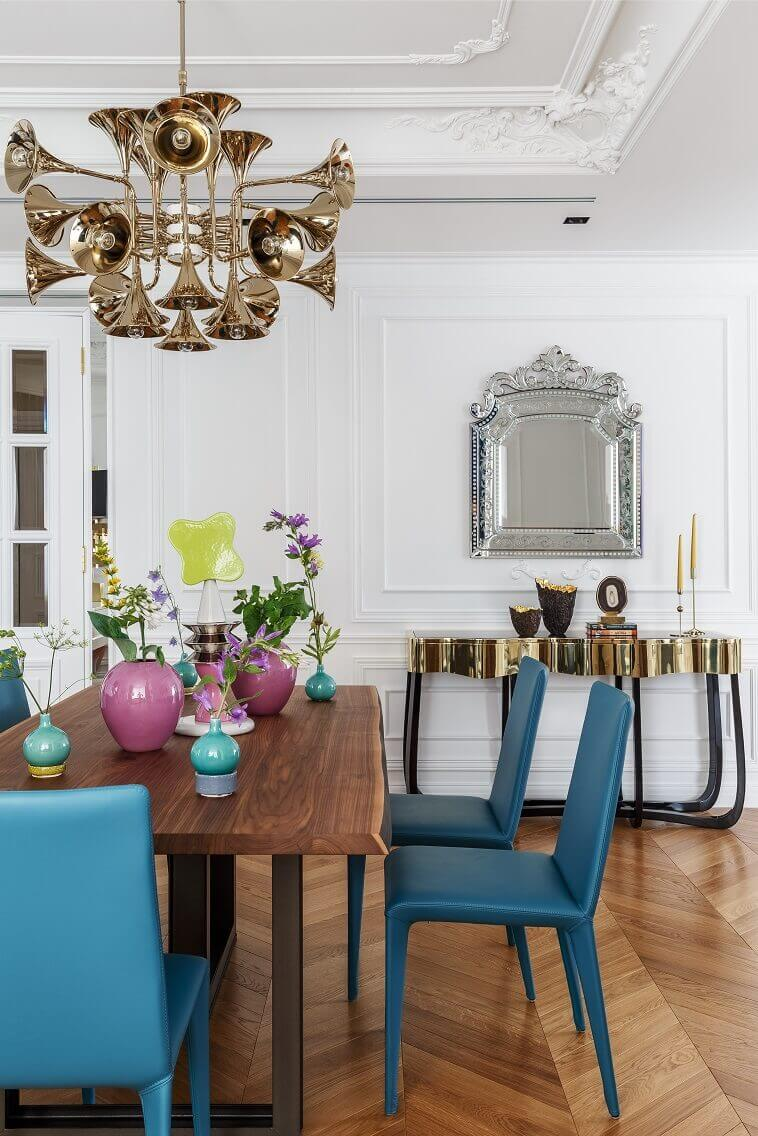 venetian mirror above console table,luxury black and gold console table,luxury chandelier musical instruments,blue chairs wood table,decorative vases for dining table,