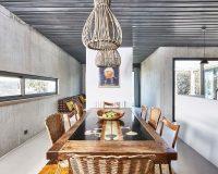 ceramic and wood dining table,natural materials in dining room interior design,wicker ceiling light shade,mediterranean dining room ideas,concrete walls interior design,