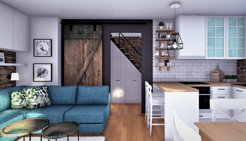 barn door living room,kitchen with small sitting area,storage space under stairs ideas,blue corner sofa for small house design,open space living room kitchen,