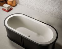 brown and white bathtub photography,acrylic oval freestanding bathtub with center drain,white brick wall decoration ideas,italian bathroom brands,contemporary bathroom ideas photo,
