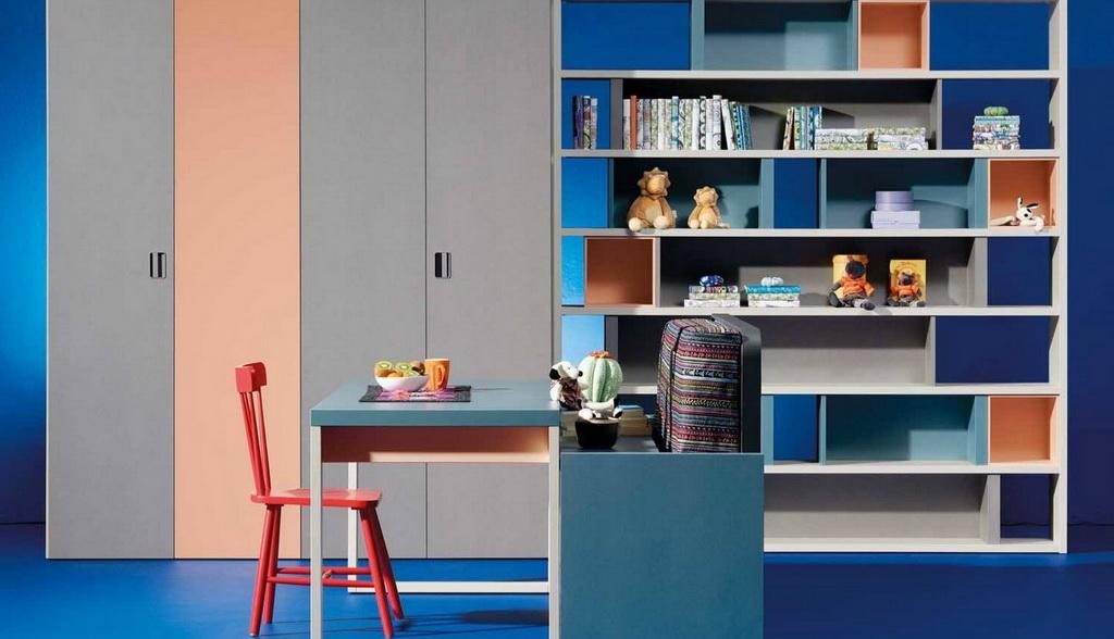 blue work desk in bedroom,blue and orange bedroom decor,kids room writing desk,blue gray kid bedroom,wardrobe and shelves childrens room,