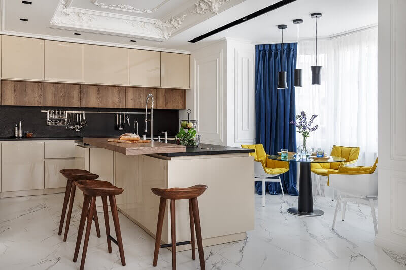 designer kitchen island with seating,wooden kitchen stools,beige wood kitchen cabinets,blue and yellow dining room decor,yellow chairs dining room,