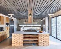aw2 architects kitchen,large kitchen with brick island ideas,concrete walls kitchen,wooden cabinets in high end kitchen,large windows in kitchen,