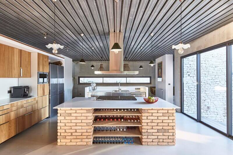 wooden cabinets in high end kitchen,large windows in kitchen,aw2 architects kitchen,large kitchen with brick island ideas,concrete walls kitchen,