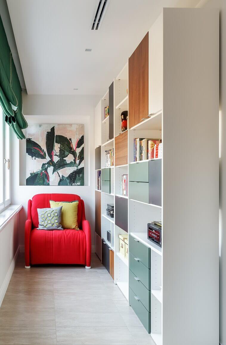 red sofa in home library,library ideas for kids rooms,girls room decor ideas,small home library interior design,bookshelf with colorful doors,