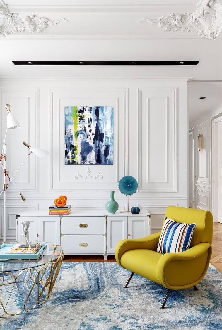 yellow modern armchair,yellow blue green white living room,coffee table inspired by jewelry,moscow luxury apartment design,colorful living room decorations,