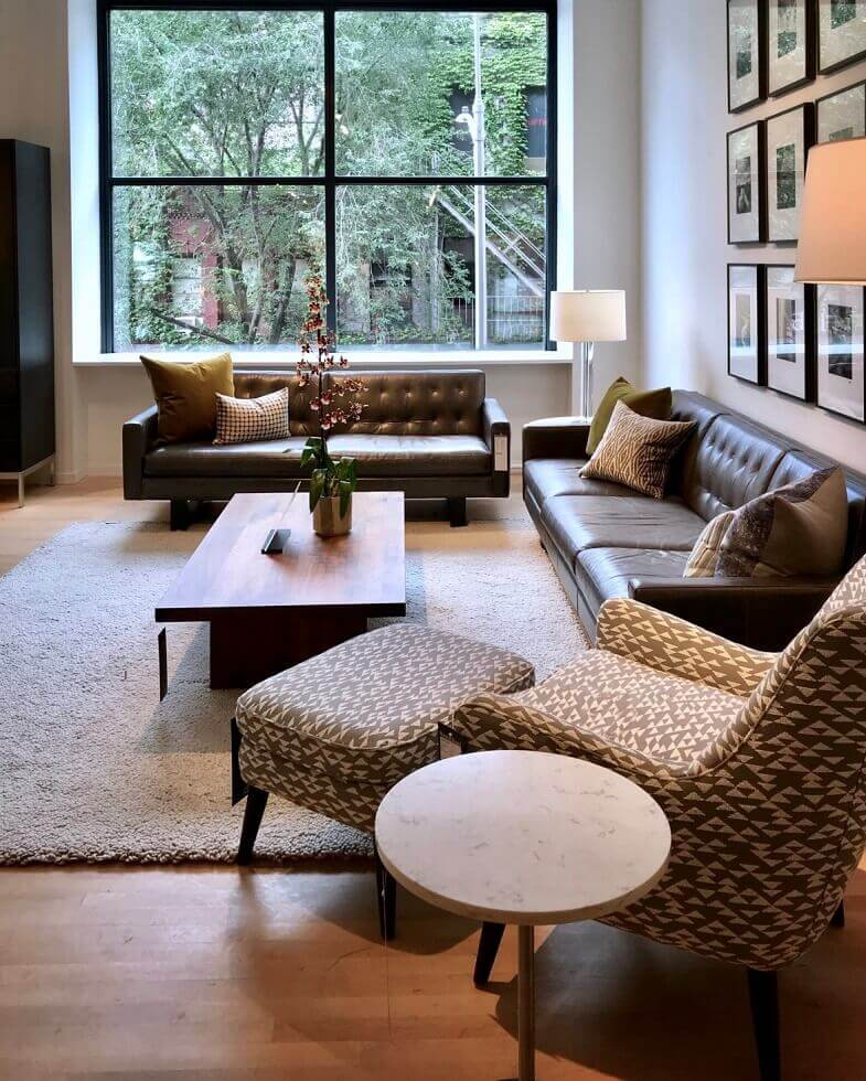 living room with large windows,how to light a living room,living room beige and brown,home decor lighting ideas,natural light in living room,