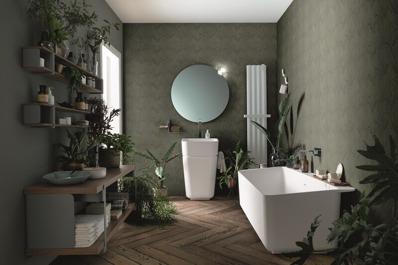 plants in home decor,greenery in bathroom,green bathroom wallpaper,white bathtub design,round mirror bathroom,